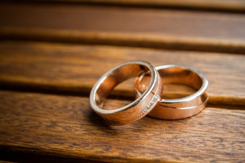 Wedding rings on wooded background